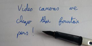 Fountain pen next to text 'Video camera are cheaper than fountain pens!'