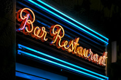 A neon sign reads Bar Restaurant