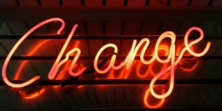 neon sign with the word change