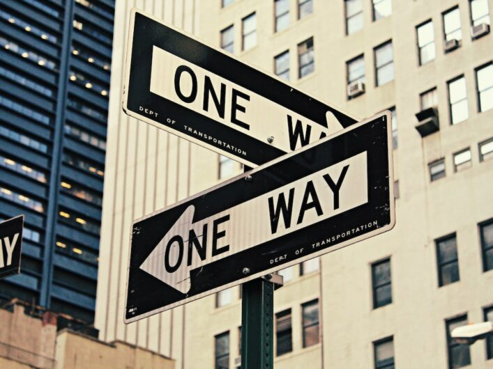 New York 'one way' signs pointing in opposite directions