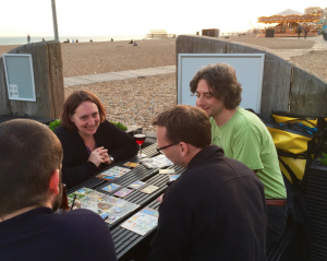 PLSIG members playing games on the beach in Brighton at a face-to-face meeting